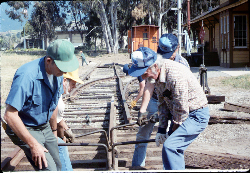 Track extension construction crew -- Ralph Moore, Gene Boswell, Malcolm Alexander, and Perry Adams, 4/18/1987. acc2005.001.0757