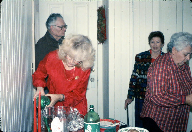 Museum Christmas Party (Phyllis Olsen, Al Volkman, Hilda Volkman, Theresa Caccese), 12/1989. acc2005.001.1234