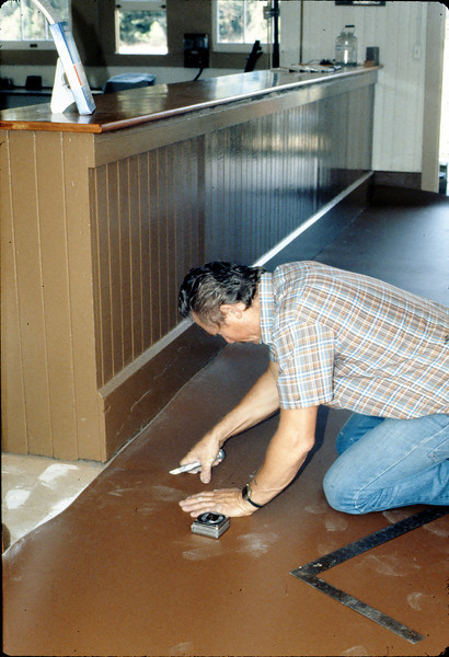 John Morelli applies new flooring in Freight Office, 9/1983. acc2005.001.0412