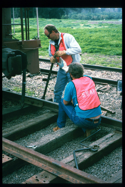 Supervised by Gene Allen, County SWAP workers lay standard-gauge track to allow the caboose to be moved northward, away from front views of Goleta Depot, late 1996 or early 1997 (Reported in Depot Dispatch newsletter, Vol 17, No. 1; Spring 1997). acc2005.001.2122