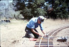 Gene Allen works on the miniature-railroad track construction, 6/1987 acc2005.001.0820