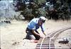 Gene Allen works on the miniature-railroad track construction, 6/1987 acc2005.001.0820