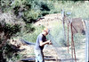 Mover repairs the perimeter fencing, 3/2/1982. acc2005.001.0185