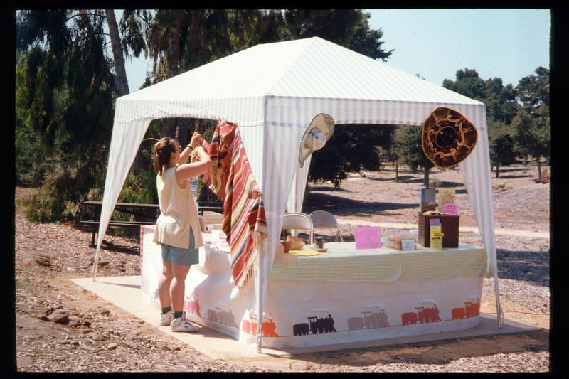 """Mary Cole helps decorate for """"El Tren de la Fiesta,"""" Aug. 6, 1994. acc2005.001.1991"""