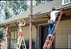 M&M Construction installs new redwood gutters, 5/1988. acc2005.001.0957