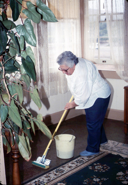Work Day (Theresa Caccese mopping floors), 1/1990. acc2005.001.1246