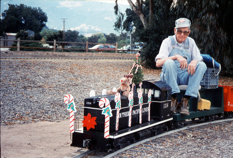 "The ""Holiday Train"" event, which later became the ""Candy Cane Train,"" was first held in 1993, from Nov. 26 thru Dec. 24. This is engineer Gene Allen. acc2005.001.1897"
