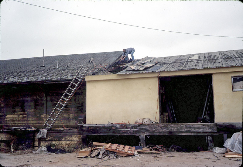 Separating small section of depot from attached shed, 11/16/1981.. acc2005.001.0056