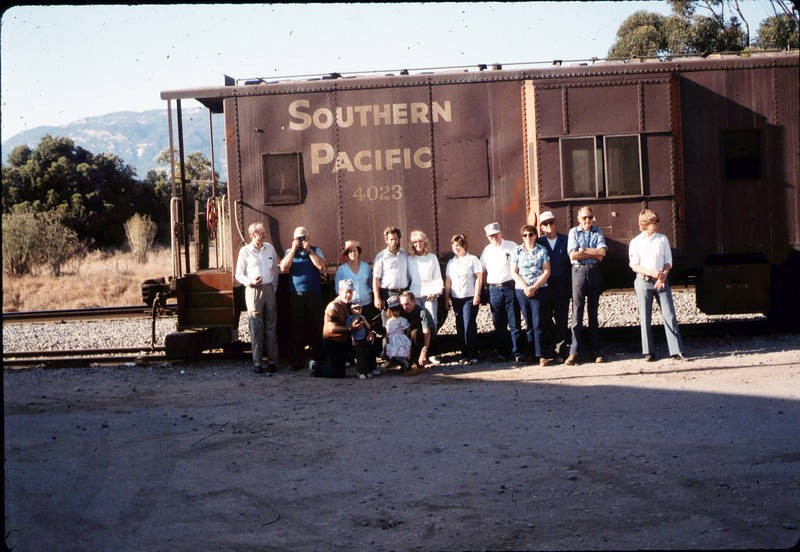 Museum friends pose with Caboose 4023 at La Patera, 9/21/1986 acc2005.001.0609