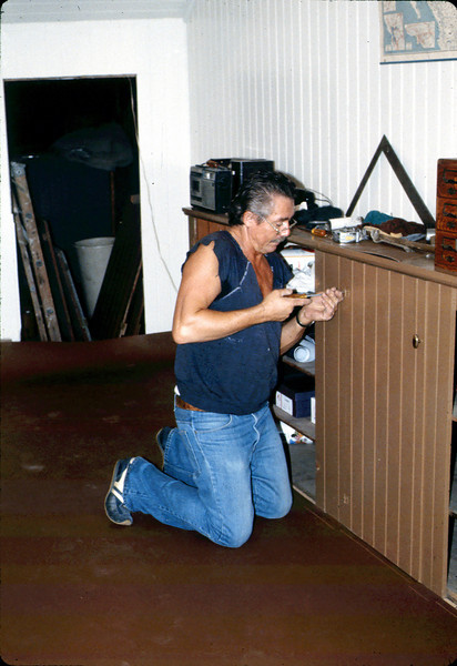 John Morelli applies new flooring in Freight Office, 9/1983. acc2005.001.0413