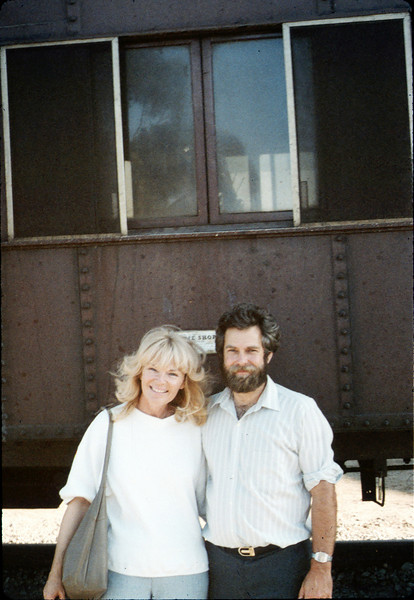 Phyllis Olsen and Gary Coombs pose with Caboose 4023 at La Patera, 9/21/1986 acc2005.001.0611