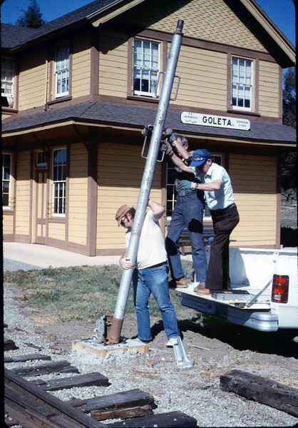 Gene Allen, Glen Apers and Glen's son install train-order post, 2/1987. acc2005.001.0689
