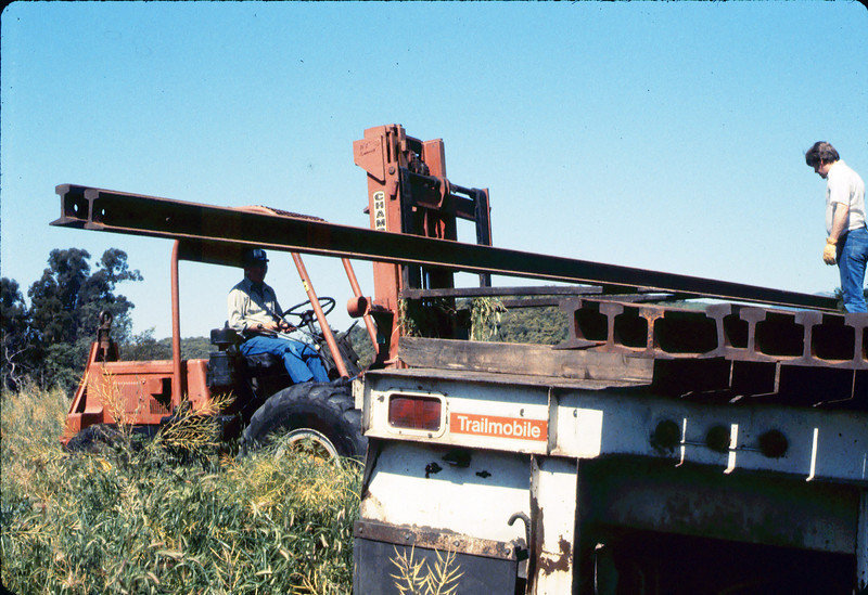 Laying of the standard-gauge track (Ed Lebeck on forklift; John Lebeck on truck), 4/2/1985 acc2005.001.0480C