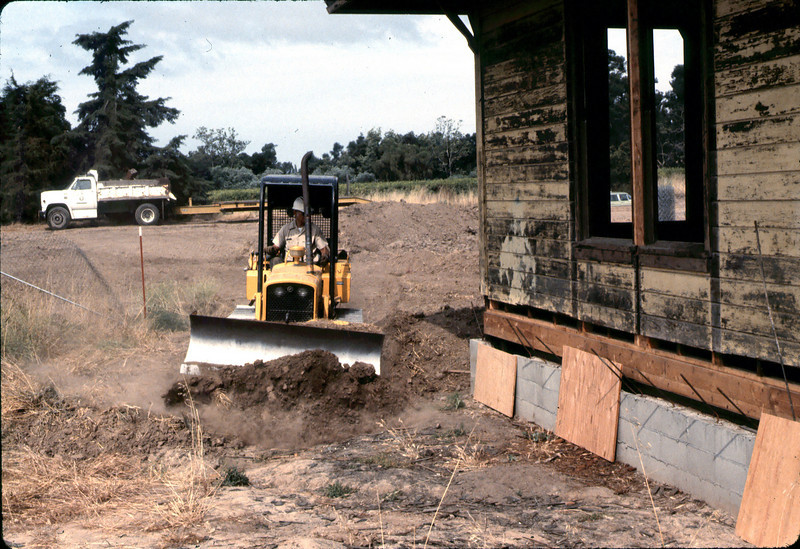 County worker backfills foundation, 6/1982. acc2005.001.0257