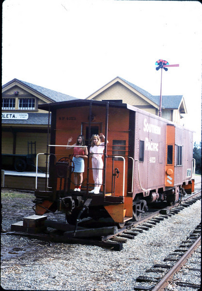 Heather and Stephanie Coombs pose on the caboose, 3/7/1987. acc2005.001.0706