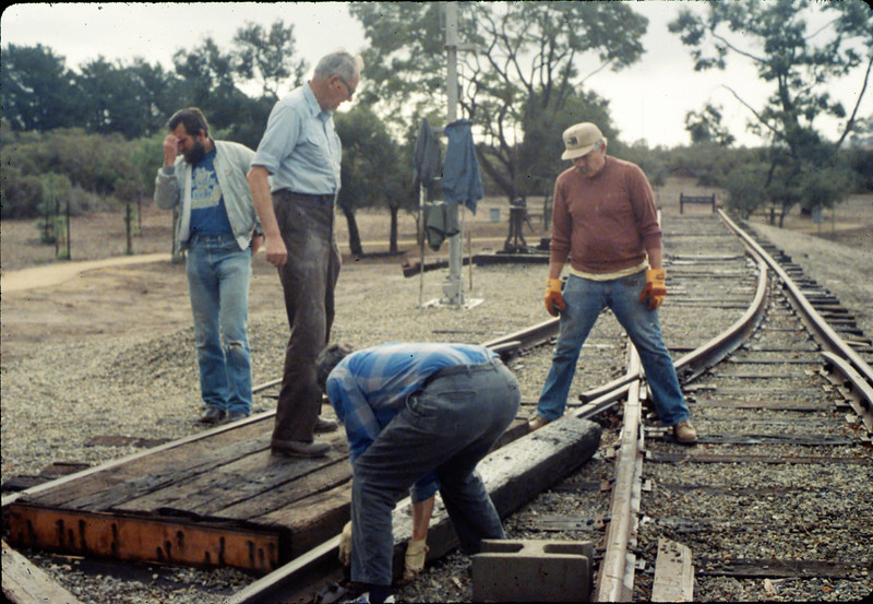 Work Day (Gene Allen, Dave Hieter & others building handcar boarding platform), 1/1990. acc2005.001.1240