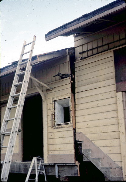 Two-story section of depot being jacked up, 11/10/1981 or 11/11/1981.. acc2005.001.0020