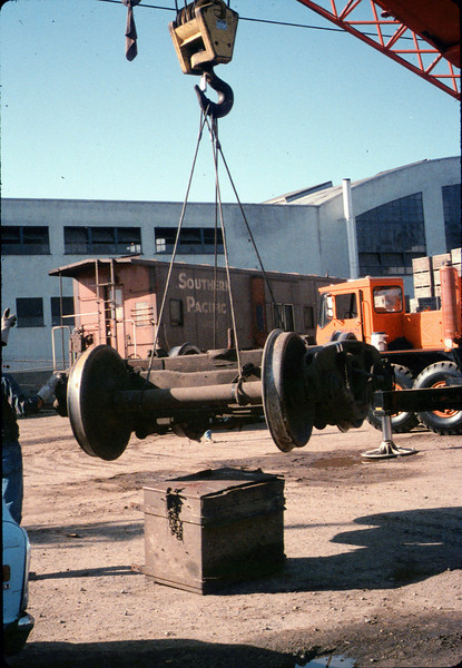 Caboose truck is lifted by crane, 9/25/1986 acc2005.001.0621
