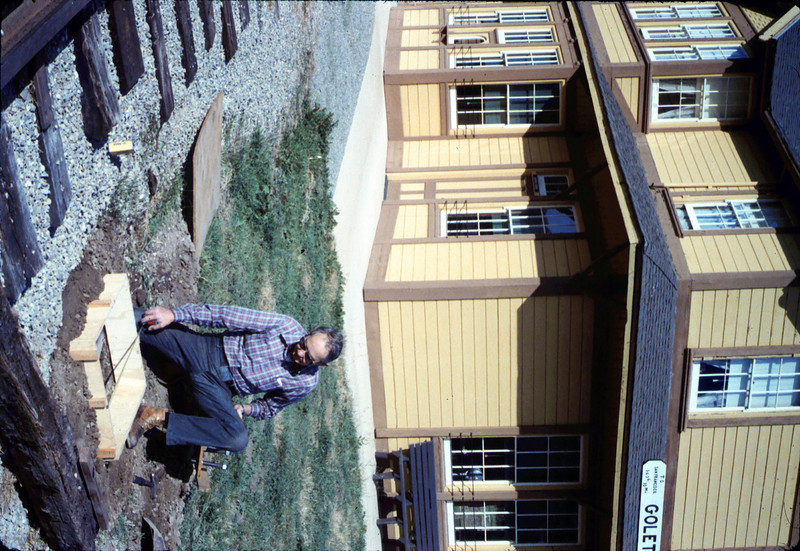 Gene Allen with foundation for train-order pole from Santa Barbara station, 1/1987 acc2005.001.0675