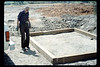 Gene Allen lays out wooden foundation for miniature-train shed, 5/1990. acc2005.001.1339