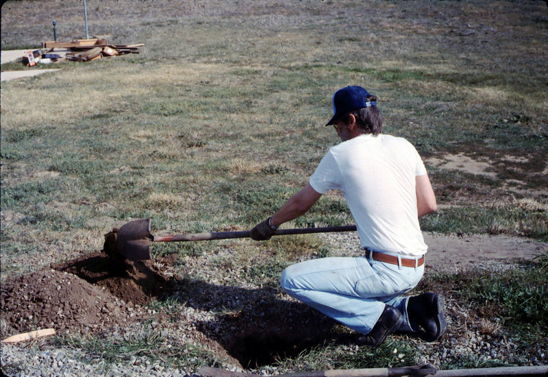 Perry Adams digs the hole for the train-order pole that was moved from Santa Barbara station, 1/1987. acc2005.001.0666