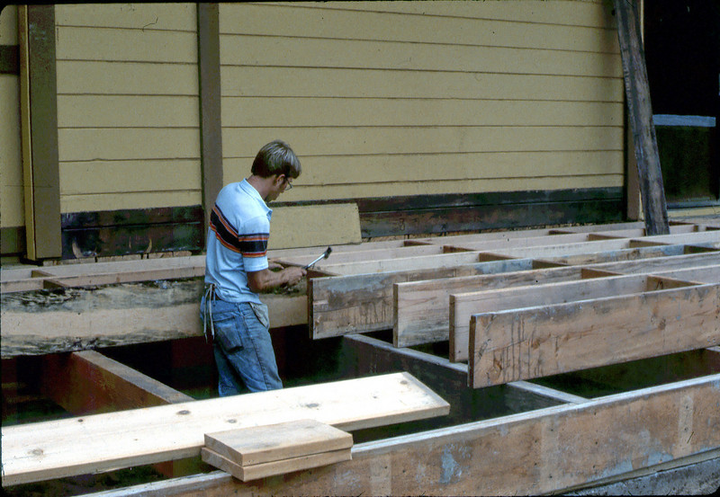 Jamie Hiestand works on loading dock construction, 9/1982. acc2005.001.0330