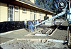 Pouring the perimeter sidewalks, 10/1982. acc2005.001.0341
