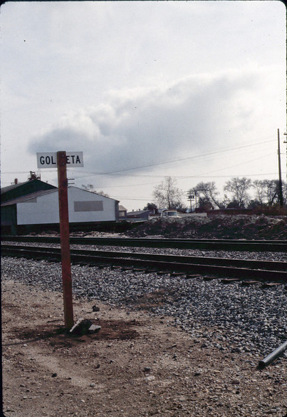New railroad station sign at depot site, Jan. 1982. acc2005.001.0136