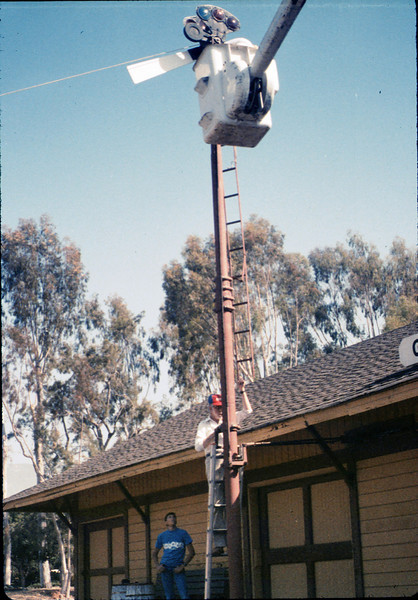 Bill Battisone, OK Tree Service, installs ladder on train-order pole, Work Day, 4/9/1988. acc2005.001.0922