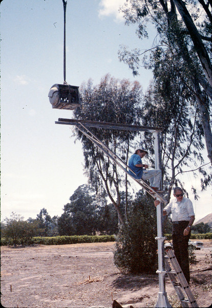 Gene Allen and Colin Hammond install wig-wag signal, 5/1989 acc2005.001.1182