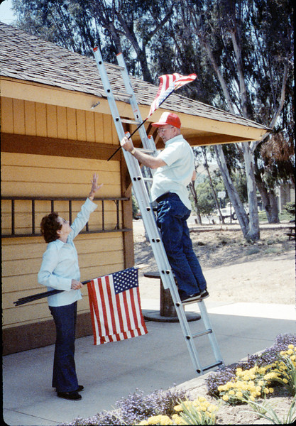 Hilda Volkman and Ed Lebeck decorate Goleta Depot with flags for Fourth of July, 7/4/1987. acc2005.001.0818