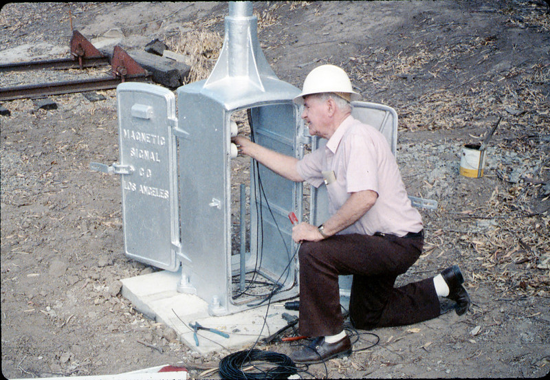 "Williard (""Bill"") Shrives helps install wig-wag signal, 5/1989 acc2005.001.1188"