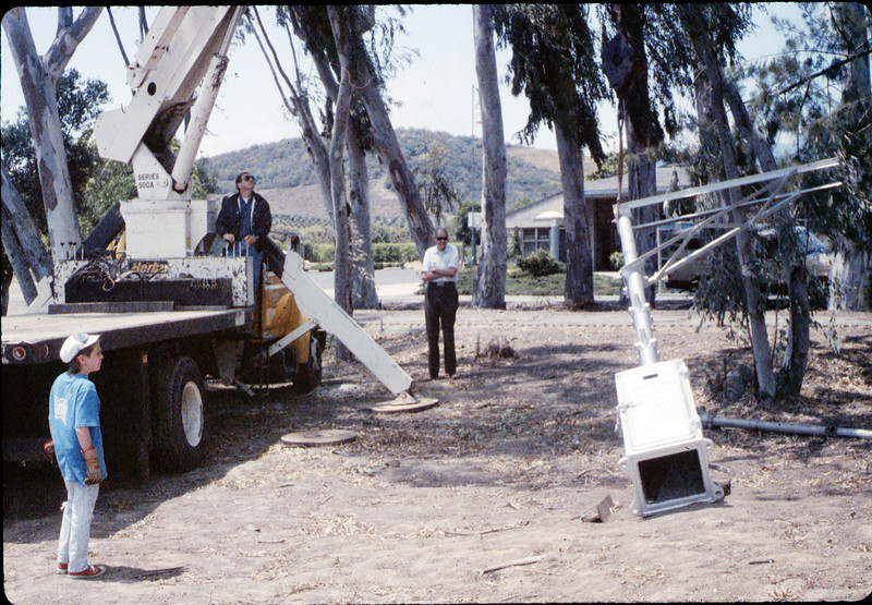 Seth and Colin Hammond (Specialty Crane & Rigging) help install wig-wag signal (gene Allen), 5/1989 acc2005.001.1171
