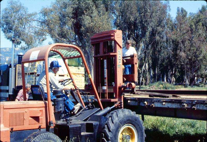 Laying of the standard-gauge track (Gene Allen; Ed Lebeck on forklift; John Lebeck on truck), 4/2/1985 acc2005.001.0480B