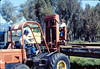 Laying of the standard-gauge track (Gene Allen; Ed Lebeck on forklift; John Lebeck on truck), 4/2/1985 acc2005.001.0480B