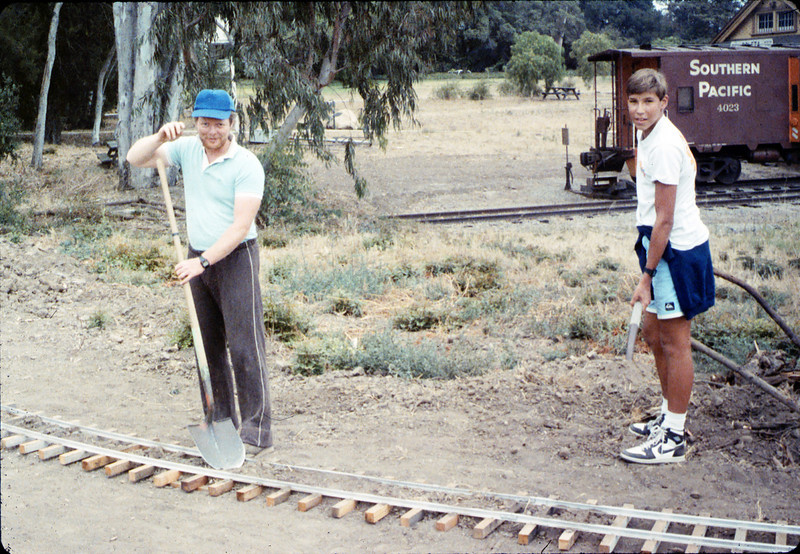 Doug Conrow and Steve Kramer help with the miniature-railroad track construction, 6/1987 acc2005.001.0815
