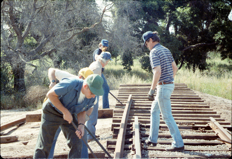 Track extension construction crew -- Ralph Moore, Gene Boswell, Malcolm Alexander, Scott Moore, and Perry Adams, 4/18/1987. acc2005.001.0747