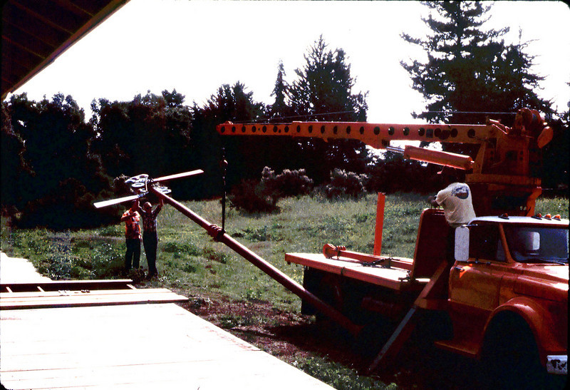 Specialty Crane & Rigging truck raises train-order pole for re-installation (Bill Everett and Gene Allen are at left-center), 10/1983. acc2005.001.0423