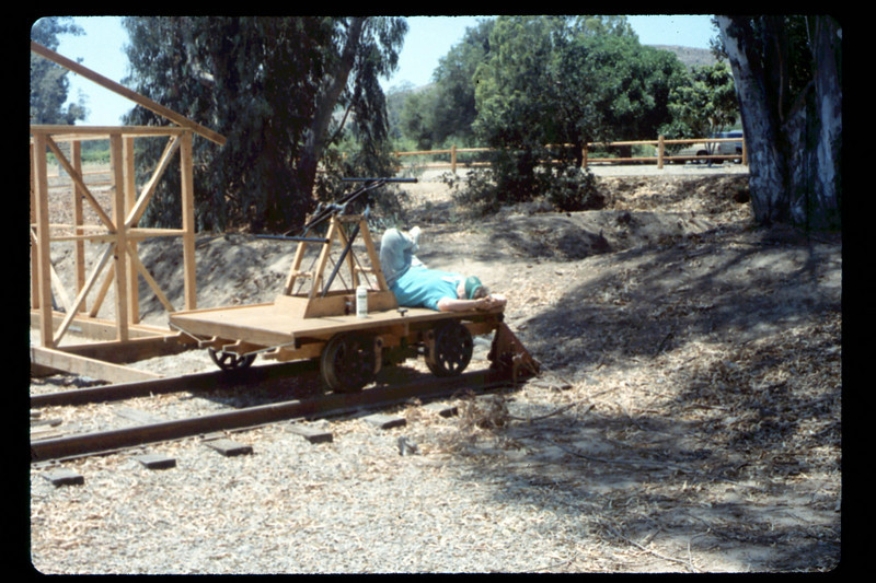 Handcar volunteer takes it easy, 6/1990. acc2005.001.1349