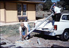 Gene Allen, Glen Apers and Glen's son install train-order post, 2/1987. acc2005.001.0687