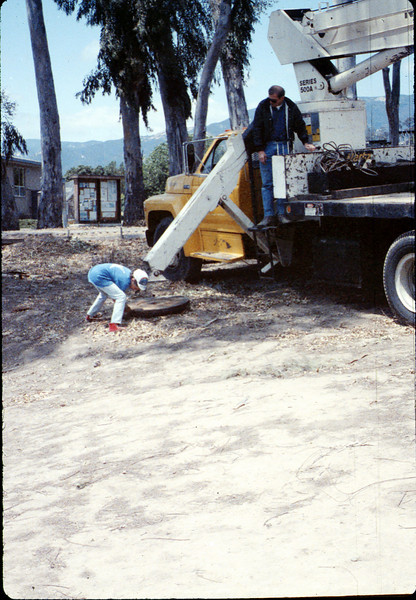 Seth and Colin Hammond (Specialty Crane & Rigging) help install wig-wag signal, 5/1989 acc2005.001.1170