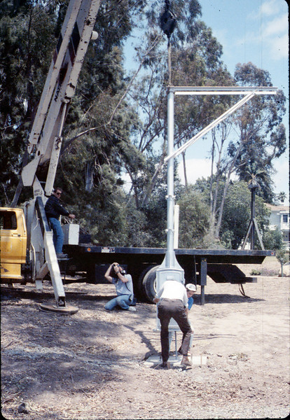 Seth and Colin Hammond (Specialty Crane & Rigging) help install wig-wag signal (Gene Allen), 5/1989 acc2005.001.1177