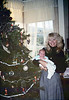 Phyllis Olsen and grandson Robert Adams at museum holiday party, 12/1987. acc2005.001.0892