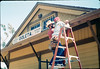 M&M Construction installs new redwood gutters, 5/1988. acc2005.001.0971