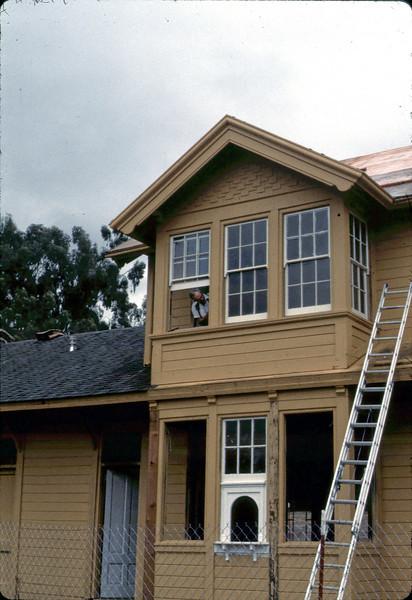 Ralph Moore installing windows, 9/1982. acc2005.001.0307