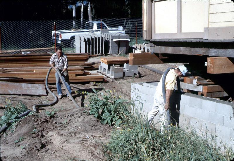 Finishing foundation work, Feb. 1982. acc2005.001.0161