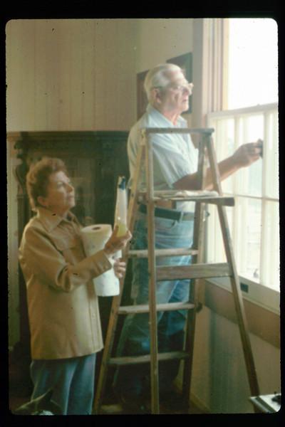 Hilda Volkman and Paul Conover wash windows, 2/1991. acc2005.001.1452