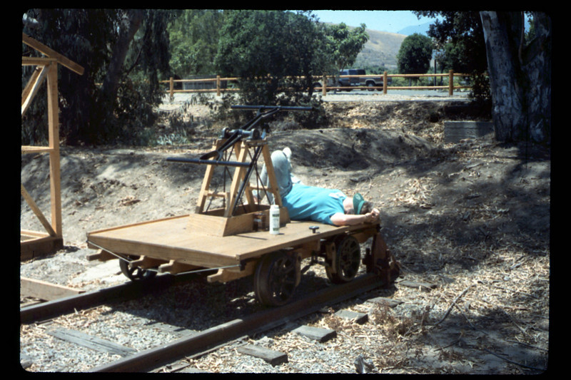 Handcar volunteer takes it easy, 6/1990. acc2005.001.1350