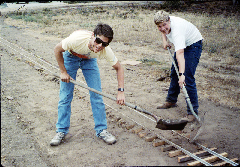Chris Leu and Scott Cogan help with the miniature-railroad track construction, 6/1987 acc2005.001.0816