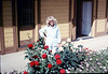Phyllis Olsen with roses donated by Harriett Phillips, 4/1988. acc2005.001.0928 acc2005.001.0928